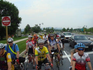 Riders Await a Traffic Light at the Start