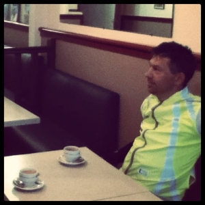 Jon at a little cafe on the way back to Paris, PBP 2011. Courtesy MG.